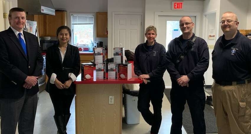 Clifton Park Town Supervisor Phil Barrett and his wife Dr. Li Zhang, at left, personally donated several hundred N-95 protective masks to be used by emergency service personnel in Saratoga County.A The couple procured the masks with their personal funds and delivered the protective items that are in short supply.