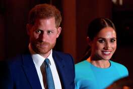 (FILES) In this file photo taken on March 05, 2020 Britain's Prince Harry, Duke of Sussex (L), and Meghan, Duchess of Sussex leave after attending the Endeavour Fund Awards at Mansion House in London. - Britain's Prince Harry, Duke of Sussex, and Meghan, Duchess of Sussex have left Canada to set up home in California, according to reports. (Photo by JUSTIN TALLIS / AFP) (Photo by JUSTIN TALLIS/AFP via Getty Images)