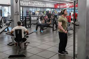 Regular members come in to use the exercise equipment at World Gym on March 18, 2020.  Fran Ruchalski/The Enterprise