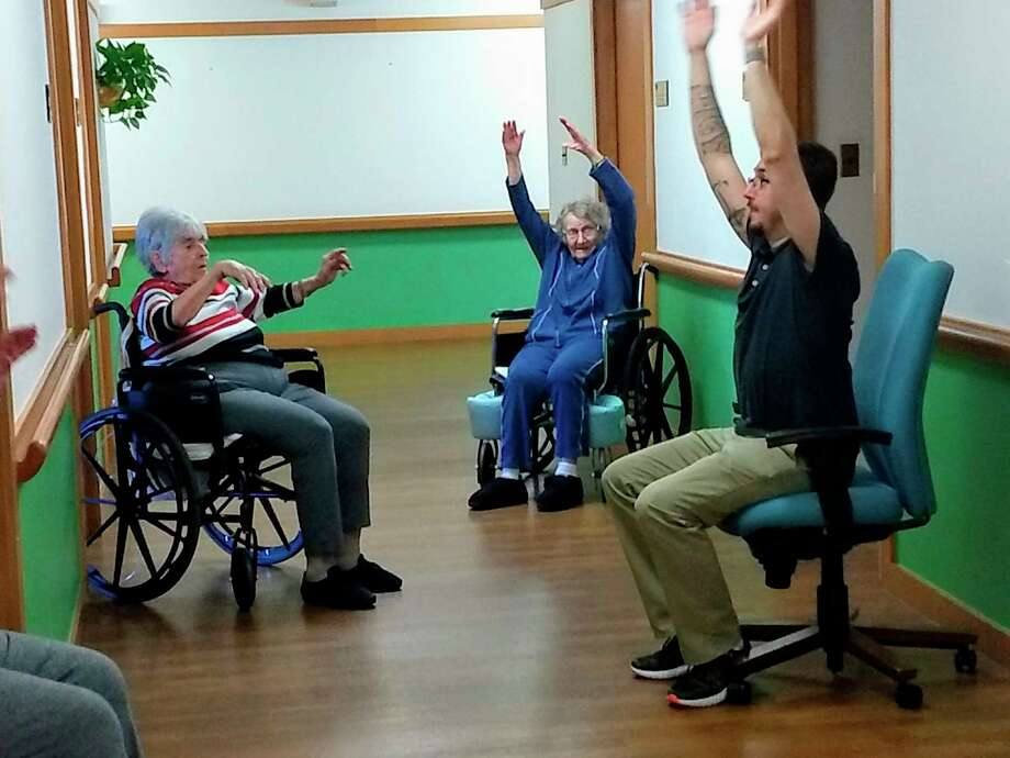 Residents at King's Daughters Home in Midland practice some exercises with a staff member. (Photo provided)