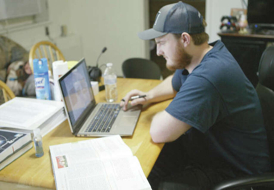 MacMurray College senior Lucaas Secrist works on a course after his classes were moved online. Photo: Samantha McDaniel-Ogletree | Journal-Courier