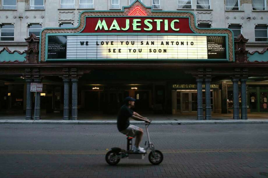"A scooter rider drives past the Majestic Theatre in downtown San Antonio, Thursday, March 26, 2020. A Stay at Home ordinance is in effect in an effort to combat the coronavirus. Among the top Google searches by San Antonians during the stay-at-home orders are unemployment and ""Tiger King."" Photo: Jerry Lara, San Antonio Express-News / **MANDATORY CREDIT FOR PHOTOG AND SAN ANTONIO EXPRESS-NEWS/NO SALES/MAGS OUT/TV   © 2019 San Antonio Express-News"