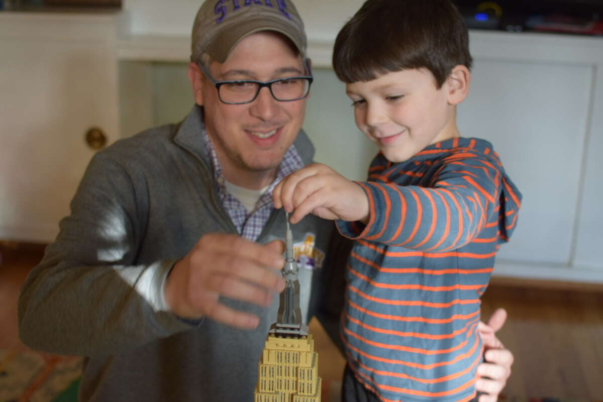 Jordan Carleo-Evangelist, of Albany, is finding the balance between his work and family life more fluid (and mixed together) amid self-isolation. He and Luke worked on building up a LEGOversion of the Empire State Building.