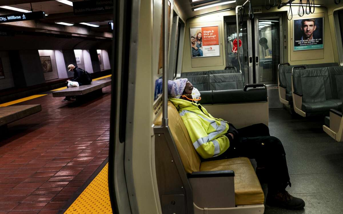 San Franciscans ride an eerily quiet Bart Transportation system as stay-at-home orders are implemented during the world-wide coronavirus outbreak in San Francisco, California Friday March 20, 2020.