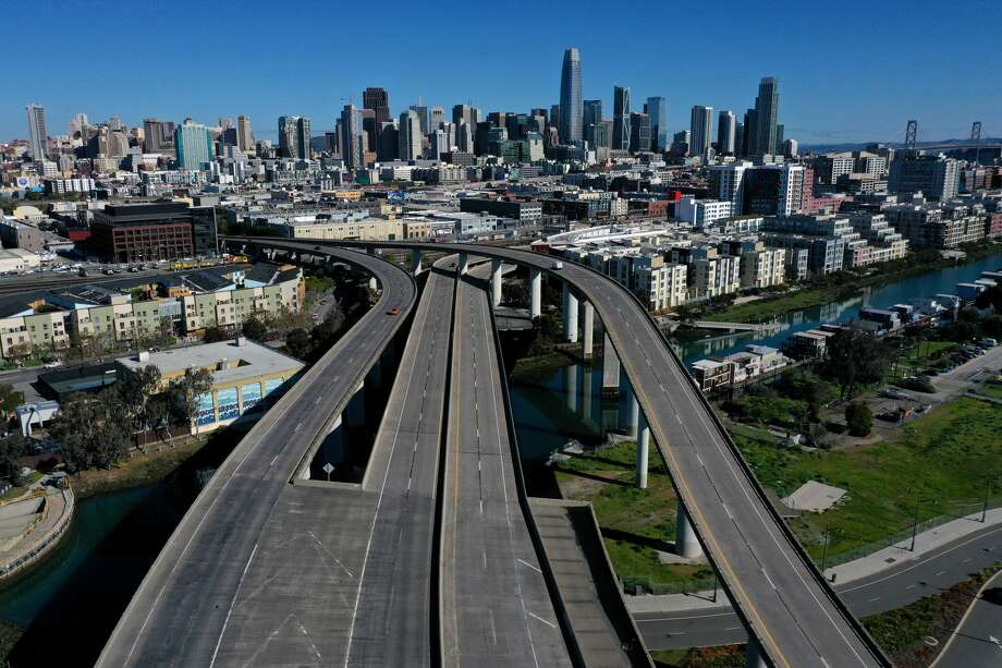 An aerial view from a drone shows an empty Interstate 280 on March 26, 2020 leading into San Francisco, California. With millions of San Francisco Bay Area residents under order to shelter in place due to the coronavirus (COVID-19) outbreak, few cars are on the roads. Photo: Justin Sullivan/Getty Images / 2020 Getty Images