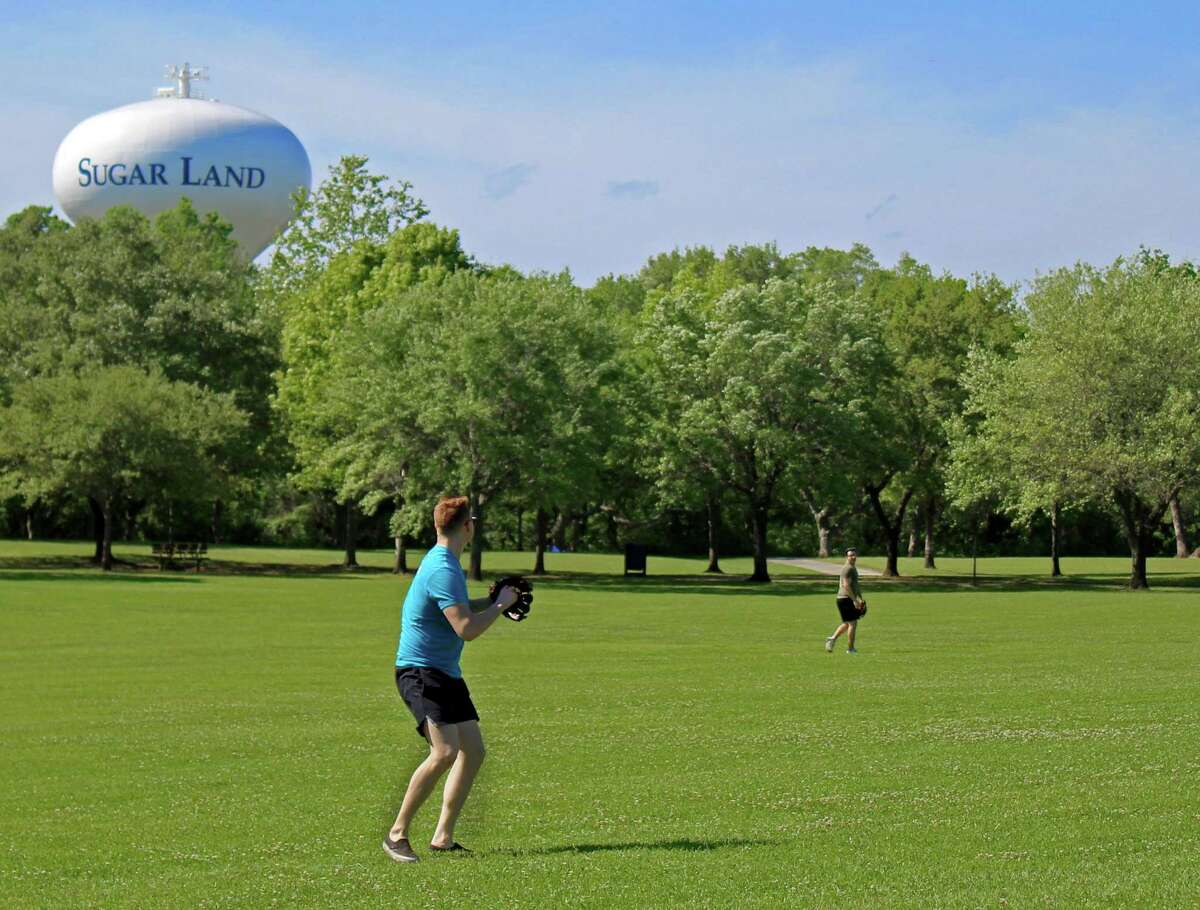 A pair of teenagers played catch at Oyster Creek Park on Friday, March 27.