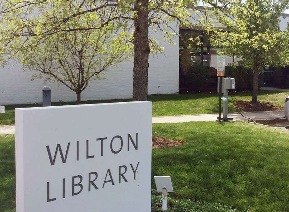 Wilton Library has announced it will remain closed until further notice, extending its closing past March 31 to meet local, state and federal guidelines for nonprofits. April programs including the library's book sale fundraiser are postponed. Photo: Contributed Photo