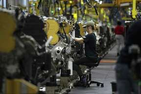An employee assembles engines at the Caterpillar Inc. manufacturing facility in Sequin, Texas, U.S. The Texas manufacturing production index, a measure of the state's manufacturing conditions based on surveys of executives, plummeted from a reading of 16.4 to -35.3 in March.