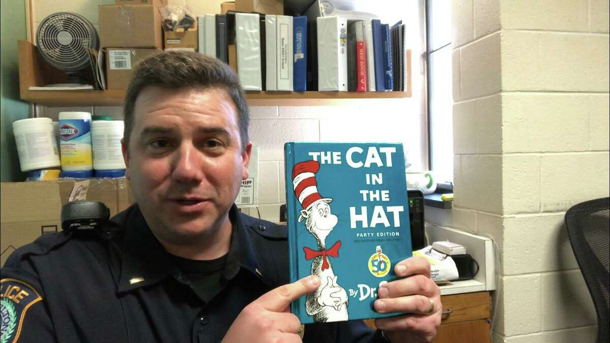 """Police Lt. Dave Hartman plans to read """"The Cat in the Hat"""" to Wilton children."""