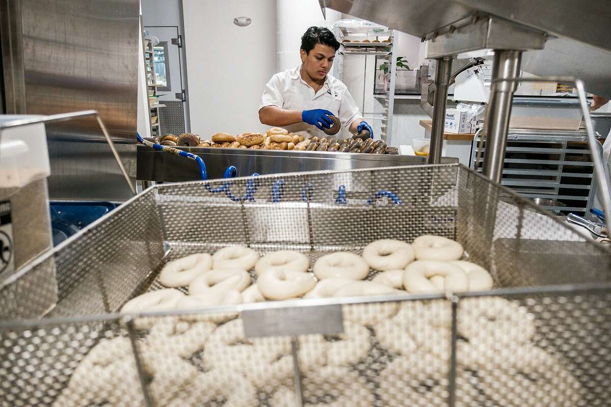 Jordan Fuentes bakes bread at Daily Driver in San Francisco, Calif. on Saturday March 28, 2020. The Bagel spot has been preparing breakfasts to be delivered to Hospital workers at UCSF as a part of Feed the Line