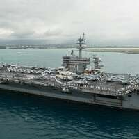 Exclusive: Captain of aircraft carrier with growing coronavirus outbreak pleads for help from Navy
