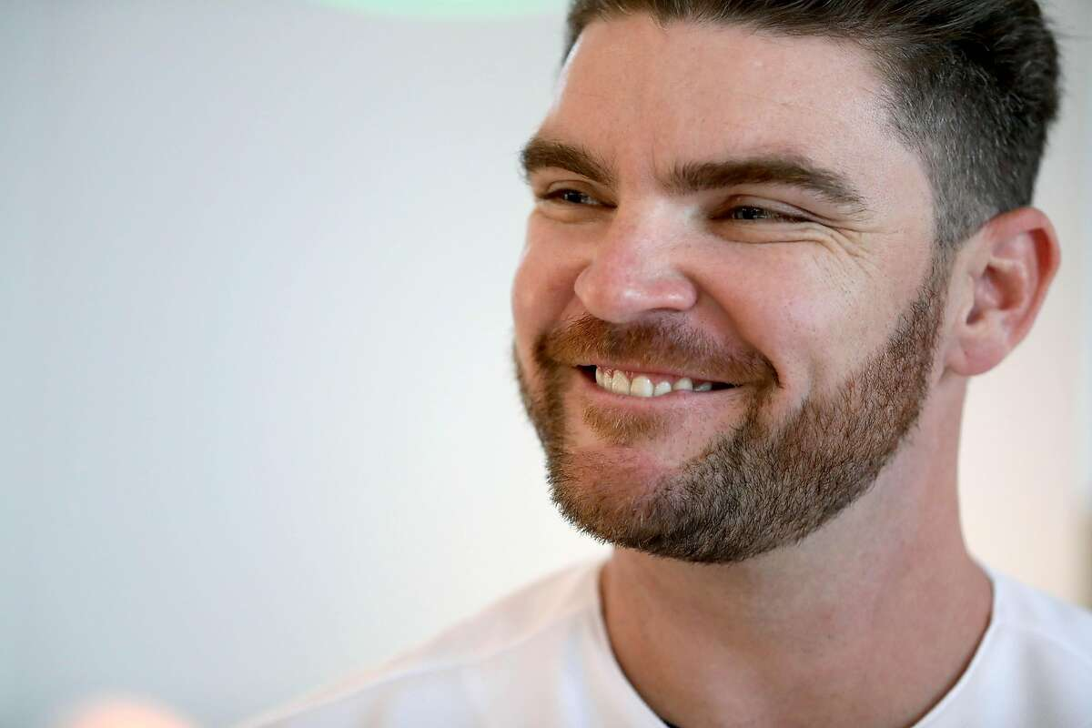 Liam Hendriks, pitcher, speaks to the press during the Oakland A's pre-Fan Fest media availability at the A's offices at Jack London Square in Oakland, Calif., on Friday, January 24, 2020.