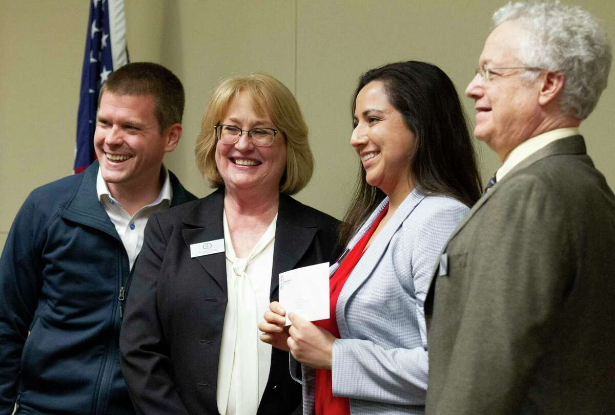 Angelica Alvarado, second from right, poses for a photo beside Brent Wunderlich, far left, Amanda Trapp and Leland Dushkin after accepting a $13,500 check on behalf of the Montgomery County Women's Center during the Montgomery County Community Foundation grant reception at Memorial Hermann The Woodlands Hospital, Thursday, Dec. 5, 2019, in The Woodlands. Right now, the Women's Center is concerned about it's financial state as its resale shop, a source of unrestricted funding, has had to close due to COVID-19.