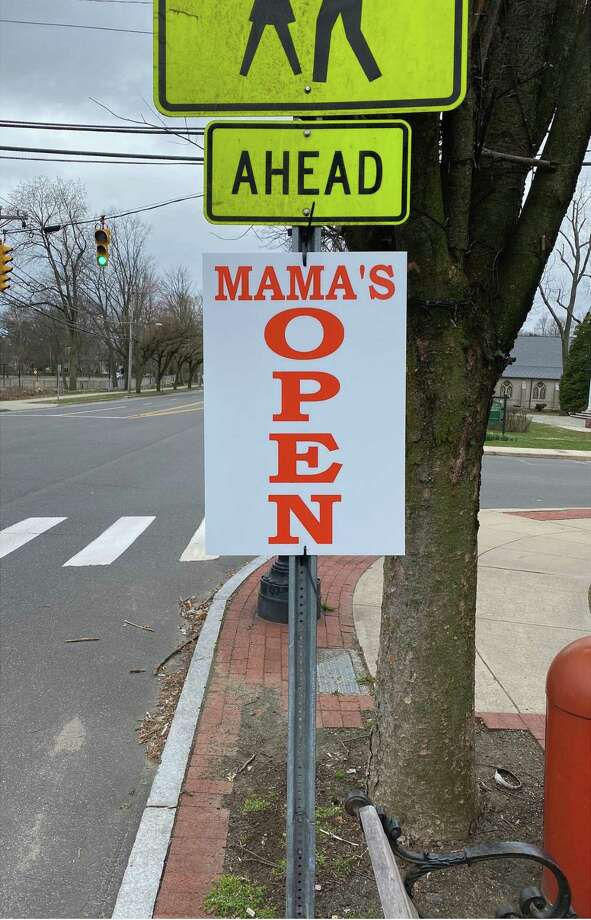 Eateries like Mama Carmela's, 1981 Post Road, 203-655-9004, have been given a temporary permit by the town's Planning & Zoning Department for sidewalk signs — Kevin Kane of Hung Well Signs in Darien has offered to make them for free for Darien businesses. Photo: Kevin Kane