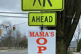 Eateries like Mama Carmela's, 1981 Post Road, 203-655-9004, have been given a temporary permit by the town's Planning & Zoning Department for sidewalk signs - Kevin Kane of Hung Well Signs in Darien has offered to make them for free for Darien businesses.