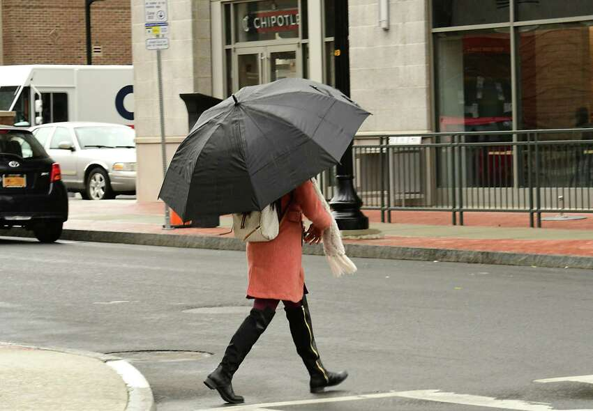 Rain, heavy at times, will hit the Capital Region today and Friday before moving out early Saturday. Times Unoinmeteorologist Jason Goughsays nice weather awaits, though, on Saturday and Sunday. In this photograph, a pedestrian uses an umbrella in the rain as she walks down New Scotland Ave. on Monday, March 30, 2020 in Albany, N.Y. (Lori Van Buren/Times Union)