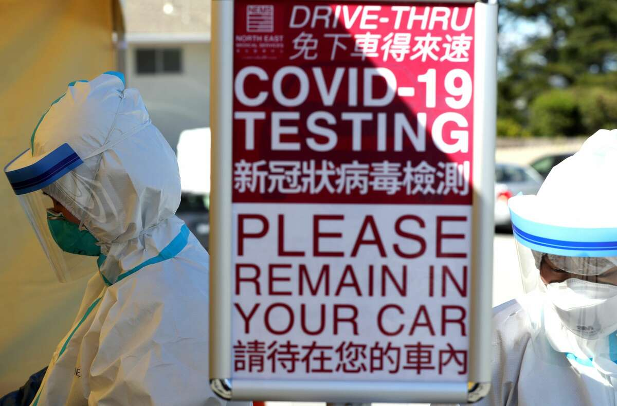 Medical professional wait to administer a coronavirus (COVID-19) test during a drive-thru testing station on March 26, 2020 in Daly City, California. New coronavirus testing stations are opening up each day in the San Francisco Bay Area.