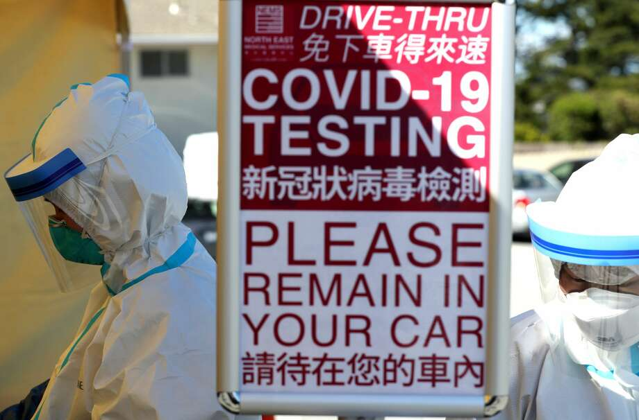 Medical professional wait to administer a coronavirus (COVID-19) test during a drive-thru testing station on March 26, 2020 in Daly City, California. New coronavirus testing stations are opening up each day in the San Francisco Bay Area. Photo: Justin Sullivan/Getty Images / 2020 Getty Images