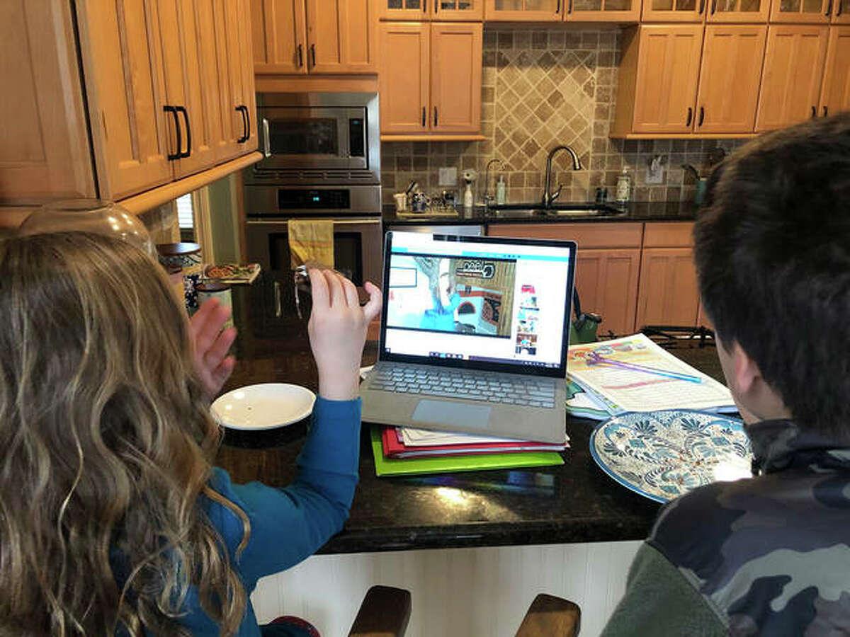 Children listen to last week's virtual storytime via livestream from the Edwardsville Children's Museum.