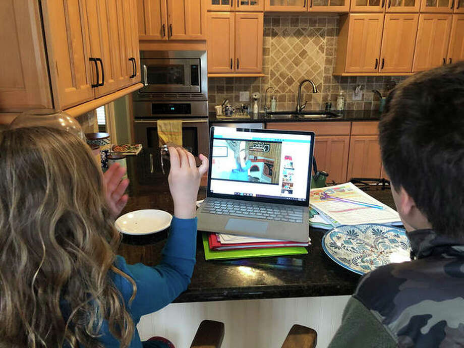 Children listen to last week's virtual storytime via livestream from the Edwardsville Children's Museum. Photo: Courtesy Of Abby Schwent/Edwardsville Children's Museum