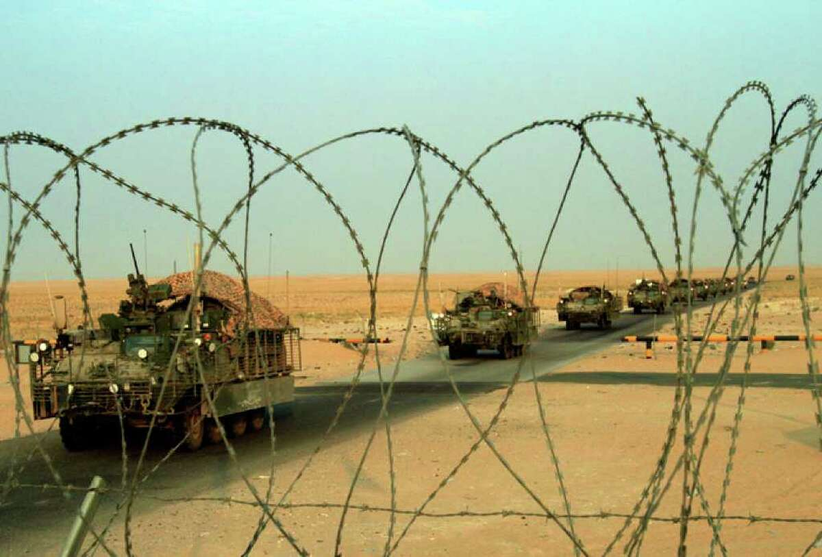 A column of U.S. Army Stryker armored vehicles cross the border from Iraq into Kuwait Wednesday, Aug. 18, 2010. The U.S. Army's 4th Battalion, 9th Infantry Regiment, part of the 4th Brigade, 2nd Infantry Division, are the last combat brigade to leave Iraq as part of the drawdown of U.S. forces. (AP Photo/ Maya Alleruzzo)
