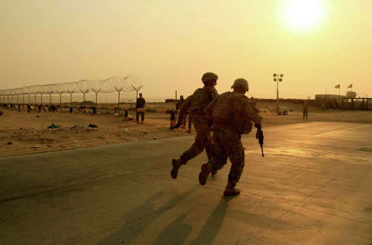 U.S. Army soldiers from 2nd Battalion, 23rd Infantry Regiment, 4th Brigade, 2nd Infantry Division race toward the border from Iraq into Kuwait Wednesday, Aug. 18, 2010. The soldiers are part of the last combat brigade to leave Iraq as part of the drawdown of U.S. forces. (AP Photo/ Maya Alleruzzo)