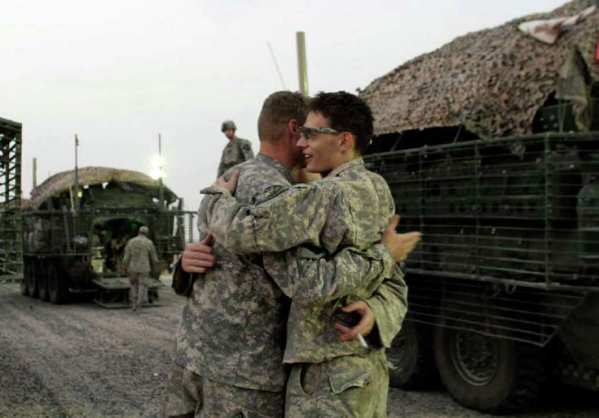 In this Aug. 16, 2010 photo, U.S. Army soldiers celebrate immediately after crossing the border from Iraq into Kuwait. The U.S. Army's 4th Battalion, 9th Infantry Regiment, part of the 4th Brigade, 2nd Infantry Division, are the last combat brigade to leave Iraq as part of the drawdown of U.S. forces. (AP Photo/ Maya Alleruzzo)