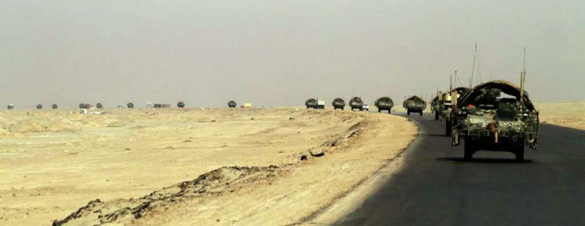 In this Aug. 15, 2010 photo, a column of U.S. Army Stryker armored vehicles from 4th Battalion, 9th Infantry Regiment, 2nd Infantry Division roll through southern Iraq en route to Kuwait. The soldiers are the last combat brigade to leave Iraq as part of the drawdown of U.S. forces. (AP Photo/ Maya Alleruzzo)