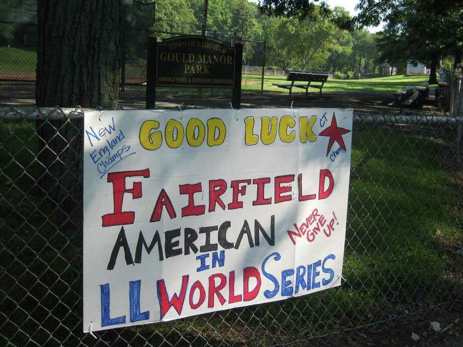 A sign at Gould Manor Park wishes the Little Leaguers success at the World Series in Pennsylvania. Photo: Tim Loh / Fairfield Citizen