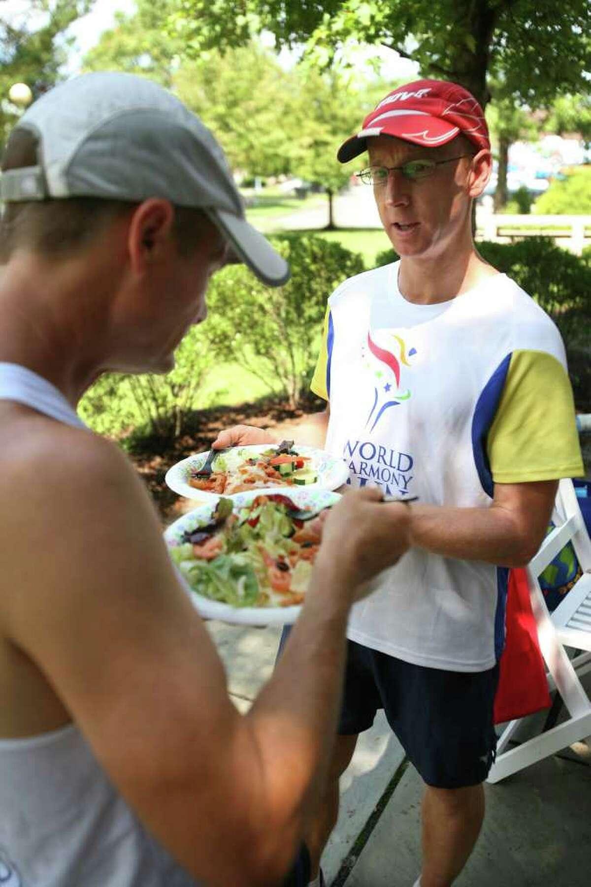 World Harmony Run runners Atulya Berube, left of San Diego, CA, and Mark Collinson of England, enjoy lunch on the Riverwalk in downtown Westport.