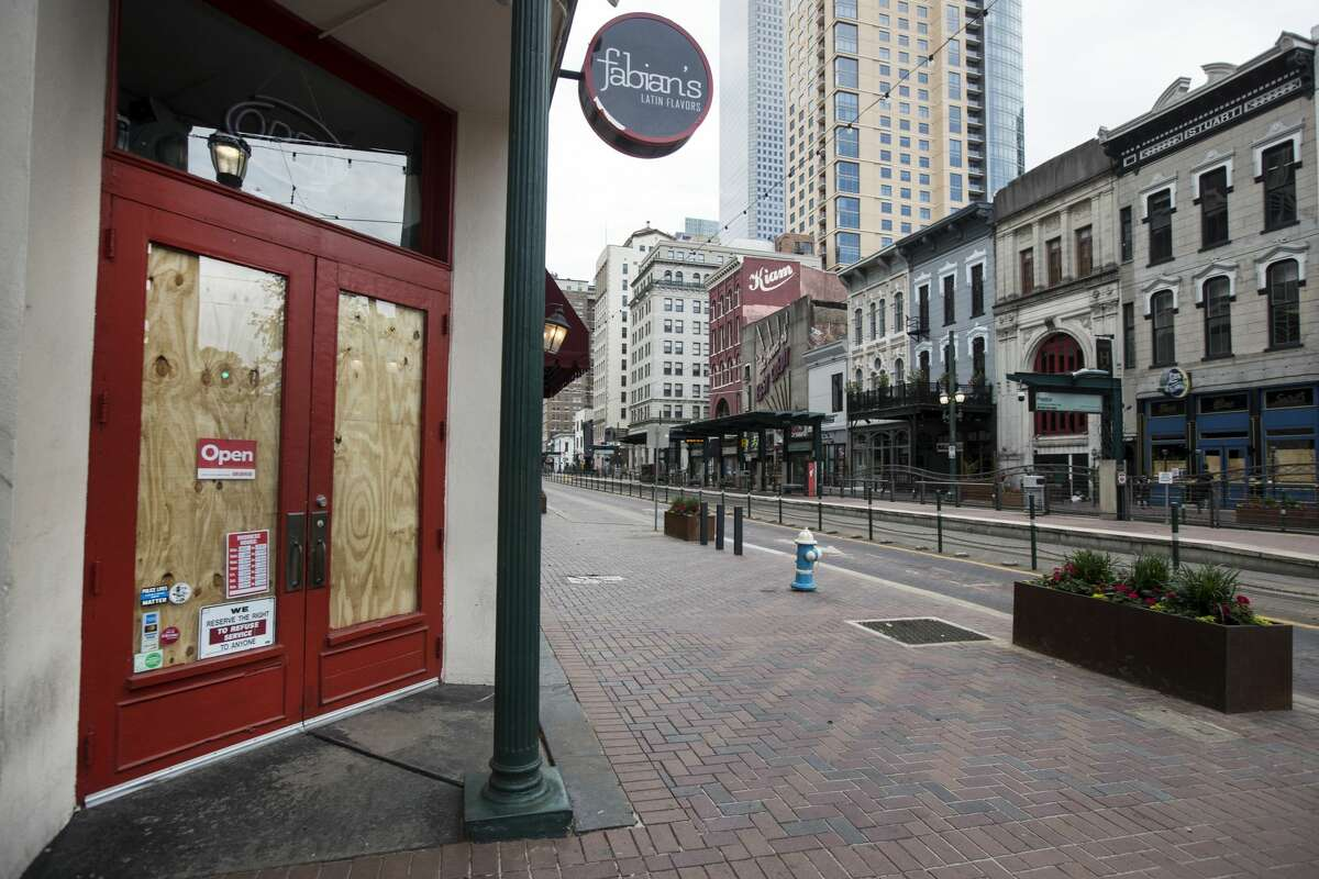 Fabian's Latin Flavors on Main Street is boarded up and closed on Saturday, March 28, 2020 in Houston. Businesses around the city have been closed and boarded up due to the coronavirus pandemic precautions, forcing several businesses to shut their doors.