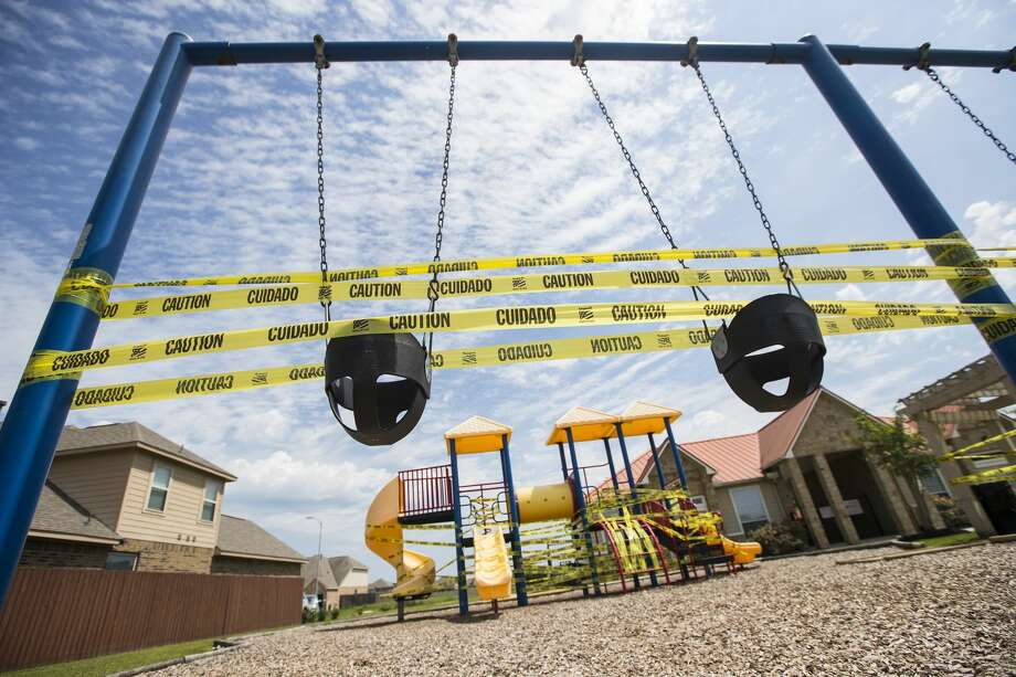 A playground is covered on caution tape, to discourage people from playing there due to coronavirus, in the Legends Trace subdivision on Sunday, March 29, 2020 in Spring. Photo: Brett Coomer/Staff Photographer / © 2020 Houston Chronicle