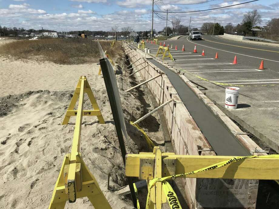 A retaining wall has been extended on the bridge side of the beach in Milford, while the annual regrading of the sand on the beach has taken place. Photo: William Bloxsom / Hearst Connecticut Media