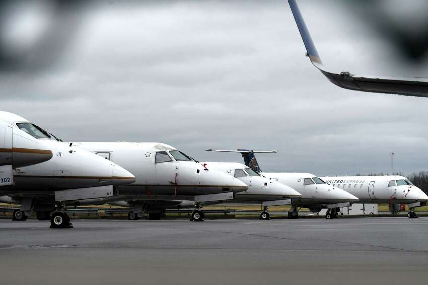 United Arlines regional jets run by CommutAir are parked at Albany International Airport during the coronavirus outbreak on Monday, March 30, 2020, in Colonie N.Y. It's a sign that air travel won't return to normal for the foreseeable future. (Will Waldron/Times Union)