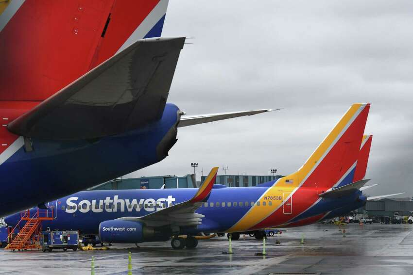Boeing 737 jets from Southwest Arlines are parked at Albany International Airport during the coronavirus outbreak on Monday, March 30, 2020, in Colonie N.Y. It's a sign that air travel won't return to normal for the foreseeable future. (Will Waldron/Times Union)