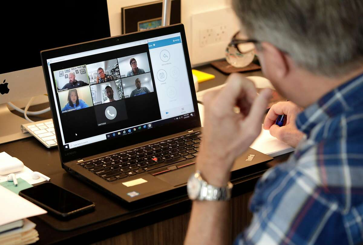 Rick Welts, President of the Golden State Warriors, joins a video conference call with staff while working from his home in Sacramento, Ca., on Thurs. Mar 26, 2020.