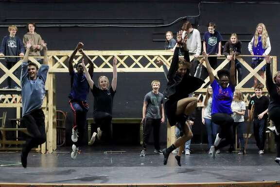 """Dickinson ISD students rehearse a scene from """"Newsies"""" before the show was presented early this year as the district's first-ever entry for the the Tommy Tune Awards. The production has won three nominations — best ensemble, costumes and stage crew/technical execution — in the competition."""