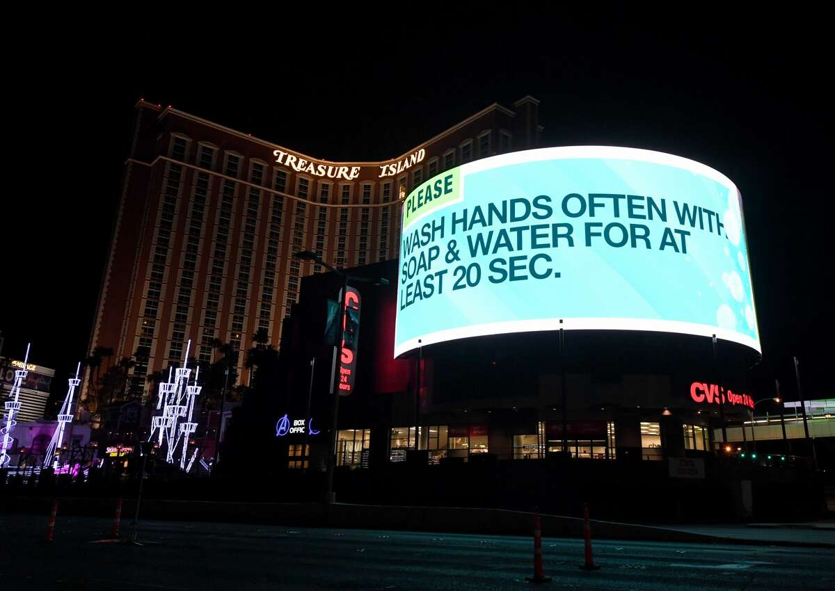 A digital sign above a CVS Pharmacy at the shuttered Treasure Island Hotel & Casino on the Las Vegas Strip displays a message about hand washing due to the continuing spread of the coronavirus across the United States on March 28, 2020 in Las Vegas, Nevada. On March 20th, Nevada Gov. Steve Sisolak ordered a mandatory shutdown of most nonessential businesses in the state until April 16th to help combat the spread of the virus. The World Health Organization declared the coronavirus (COVID-19) a global pandemic on March 11th.