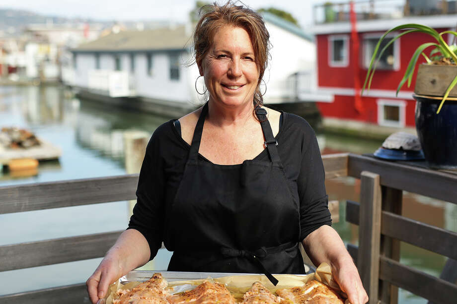 Chef Maria Finn prepares meals for a new dinner delivery service in Marin called Port & Provisions, which also offers free meals through the donation-funded No Neighbors Left Behind program. Photo: Kristine Barrett