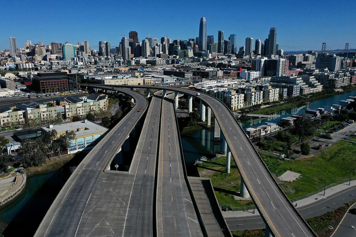 An aerial view from a drone shows an empty Interstate 280 on March 26, 2020 leading into San Francisco, California. With millions of San Francisco Bay Area residents under order to shelter in place due to the COVID-19 outbreak, few cars are on the roads.