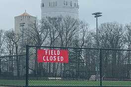 A sign turns away those who would use the field between New Canaan High School and Waveny Park on Monday, March 30. 2020. New Canaan closed all town and school parks and fields to stop gatherings in an effort to slow the spread of the coronavirus.