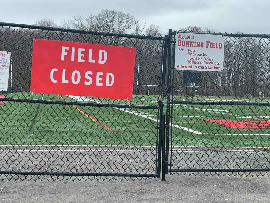 The lower entrance to Dunning Field is locked, and a sign notifies guests that it, and other fields around New Canaan, are closed. Photo: John Kovach / Hearst Connecticut Media / New Canaan Advertiser