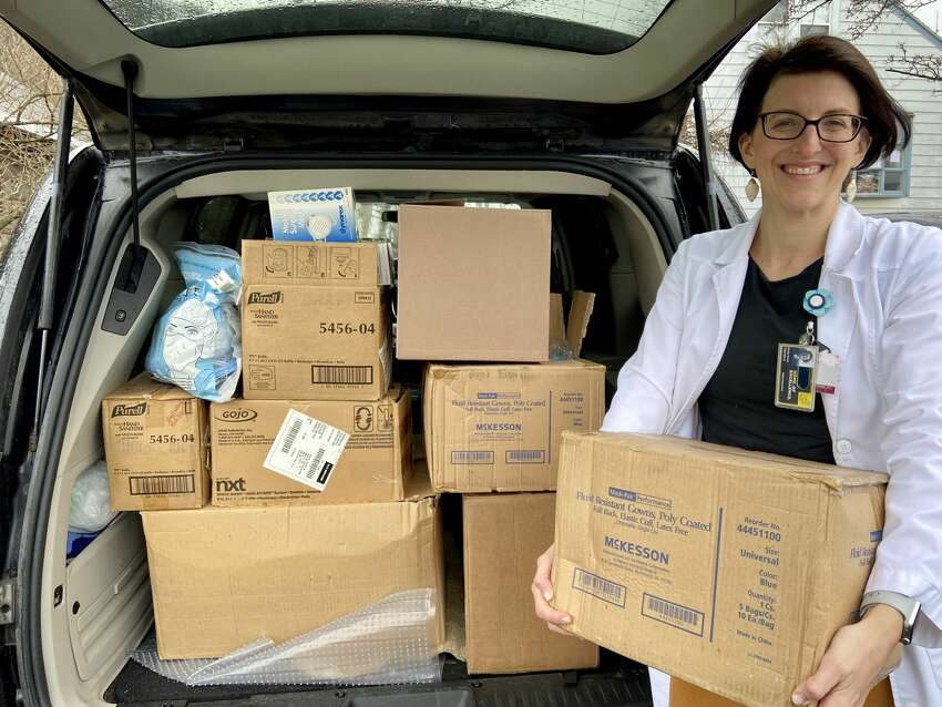 Emily Ilowit, a nurse practitioner at the College of Saint Rose, collects gloves, masks, disinfecting wipes and other supplies to donate to Albany Medical Center to help protect healthcare workers against COVID-19 on March 30, 2019.