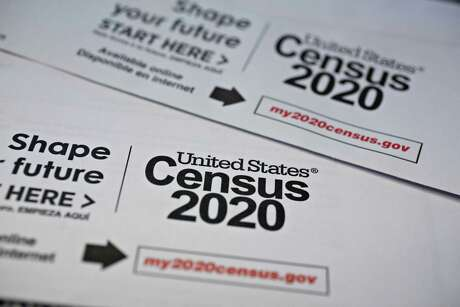 U.S. Census 2020 mailings are arranged for a photograph. The U.S. Census Bureau has suspended all field operations for the 2020 count until April 15 on coronavirus concerns.