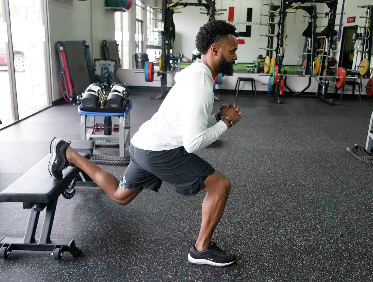 Trainer Leo Johnson demonstrates a rear foot elevated single leg squat.