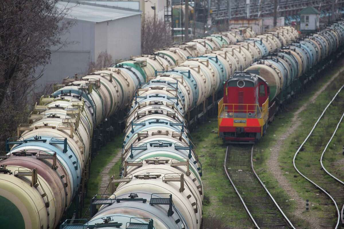 Oil trains wait at a rail yard in Russia, which is nearing a truce with OPEC to cut production and raise crude prices.