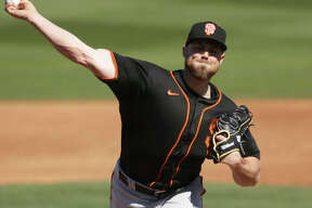 San Francisco Giants pitcher Sam Coonrod throws during the third inning of a spring training game against the San Diego Padres on March 1 in Peoria, Ariz. The Carrollton native is staying in shape during the coronavirus shutdown and hopes to remain on the Giants major-league when the 2020 season begins.