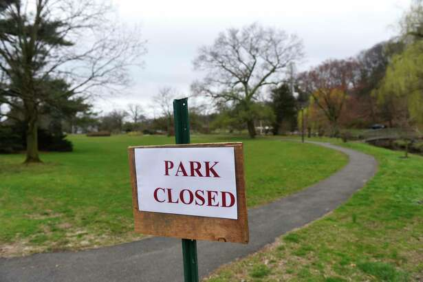 A closed sign is displayed outside Binney Park in Old Greenwich, Conn. Monday, March 30, 2020. Greenwich parks are closed to help combat the spread of coronavirus and police have begun enforcing the ban.