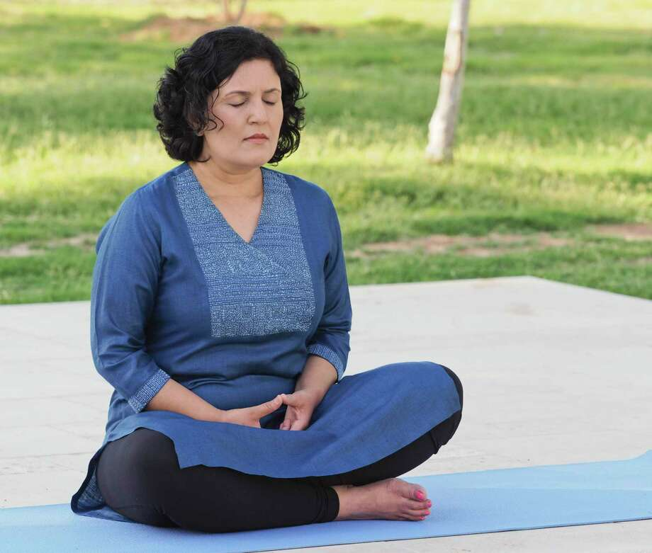 Dr. Padmaja Patel practices meditation in her backyard in this photo from 2018. Photo: Tim Fischer / Midland Reporter-Telegram