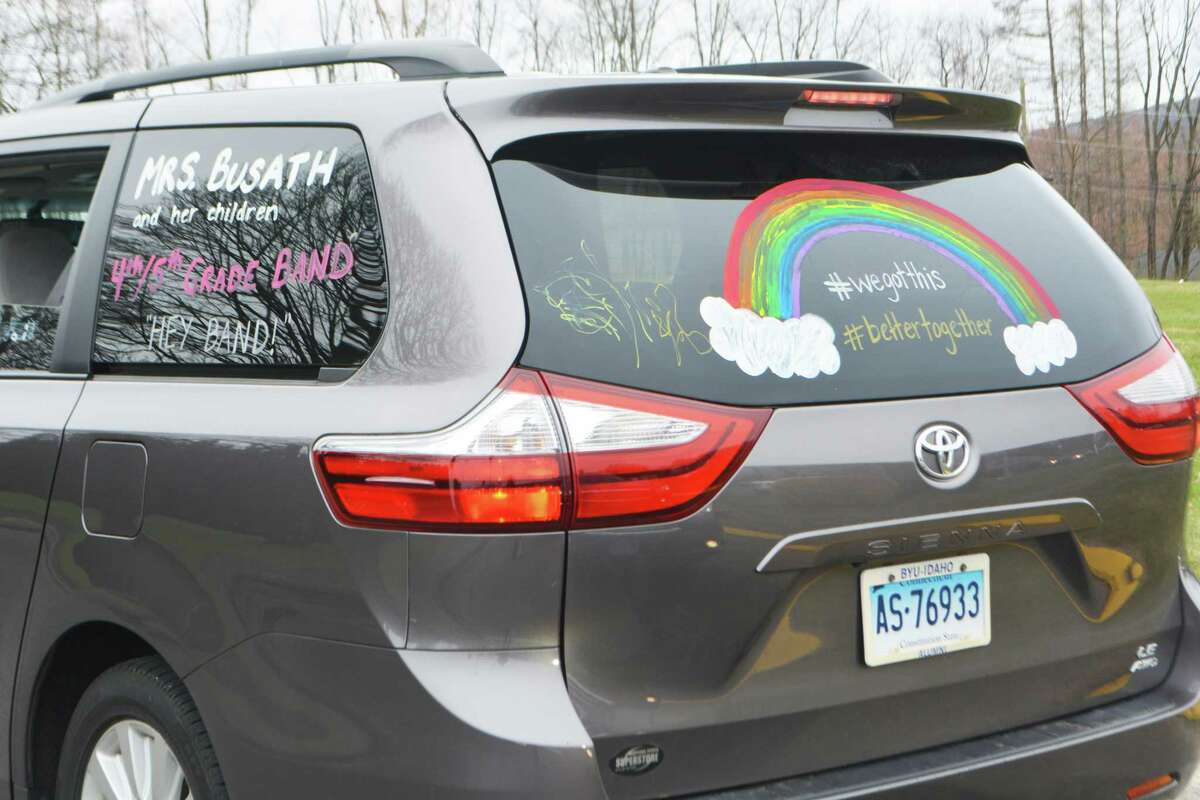 Moody School teachers and staff decorated their vehicles with cheerful messages to their students just before proceeding around the community greeting students.